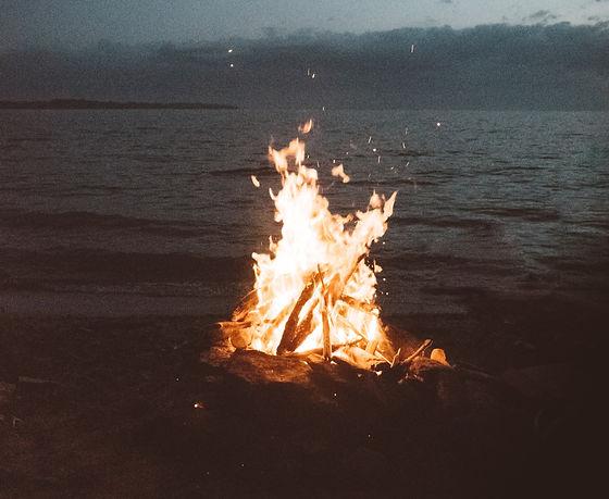 bonfire%20near%20seashore%20during%20nighttime_edited.jpg