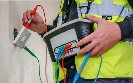 electrician testing EICR