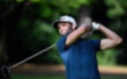 will roebuck in golf tournament wearing titleist hat