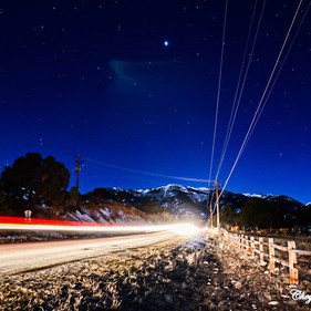 Light trails from a vehicle heading West towards the mountains.