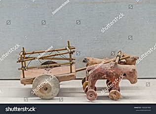 stock-photo-terracotta-toys-tops-cart-of