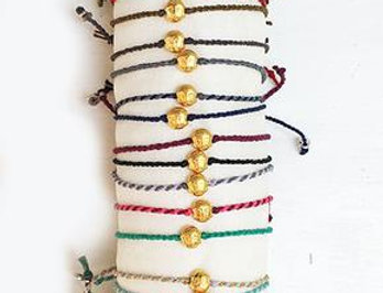 A tiny buddha bracelet/anklet