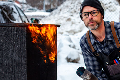 Dan Nystedt flame staining wood for If We Were Birds, In Your Eyes Projects, theatre in Sault Ste. Marie