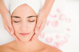 attractive-woman-receiving-facial-massag
