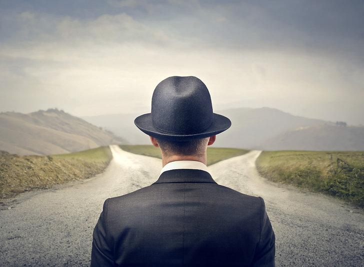 Man-Choosing-Between-Two-Roads-1024x753.