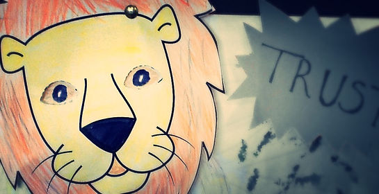 A drawing of a lion with Sunday School heading overwritten