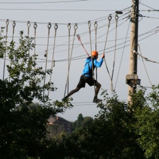 Adult walking on high ropes