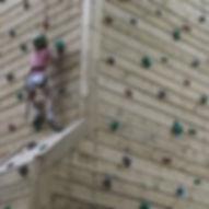Girl climbing an indoor wall at Stanley Head OEC