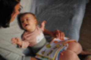 Baby-Reading-with-Mother-on-sofa.jpg