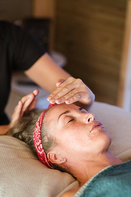 pregnant woman having a face massage