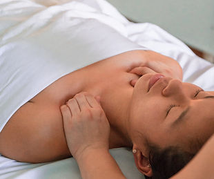 lady having manual lymphatic drainage treatment to aid relaxation