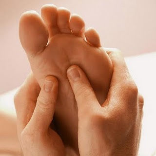 foot receiving reflexology treatment for insomnia and to improve sleep patterns