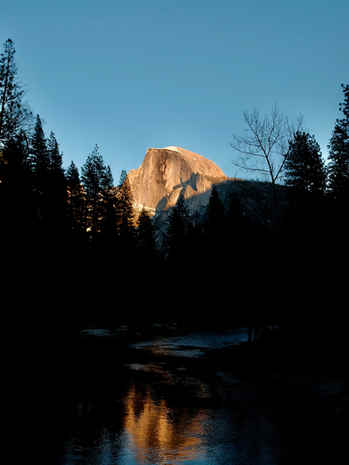 Half Dome at sunset and it's reflection