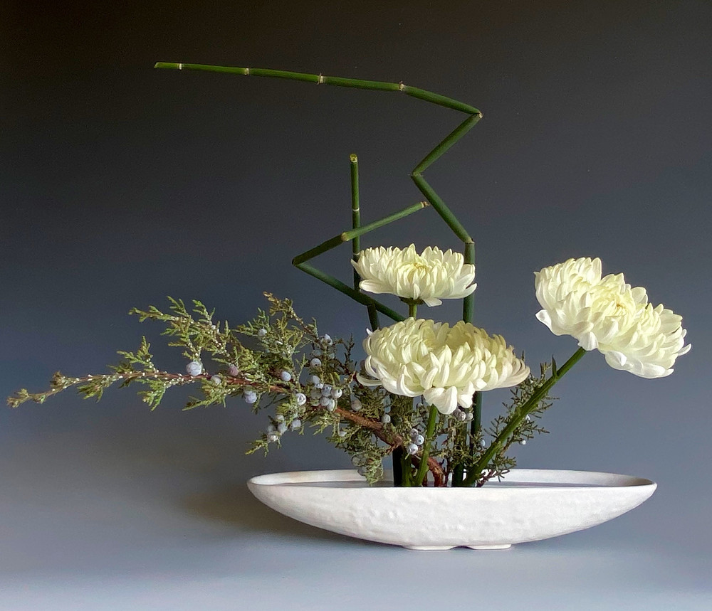 Japanese holiday arrangement with chrysanthemum, cedar and horsetail.