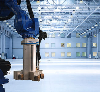 RYOEI USA EcoShot Spray System installed on Yaskawa robot