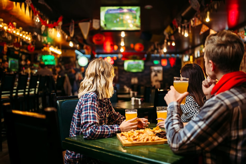 fans-watching-match-and-drinks-beer-in-s