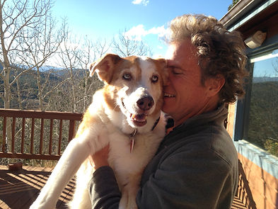 Jasper T. Fetchmeister at 14 -- one year after cancer surgery. With Mountain Dog Whisperer on the deck of their home.