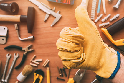 Maintenance handyman gesturing thumb up