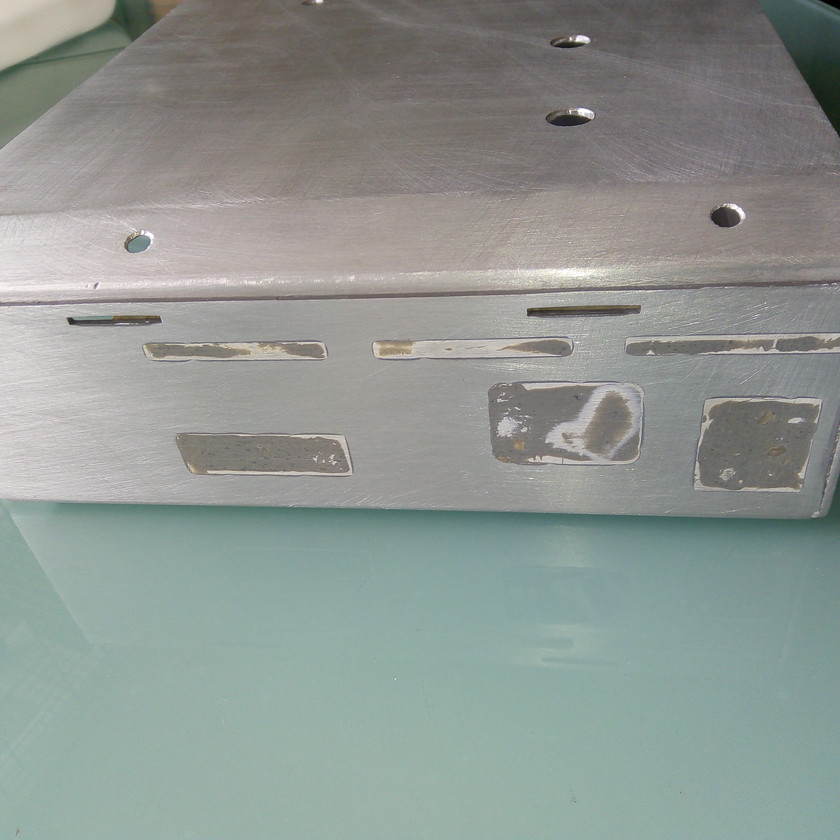Filler in original holes in case.