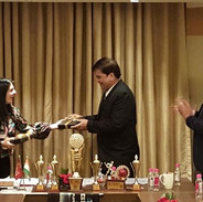 Aarti Asrai Receiving an Award