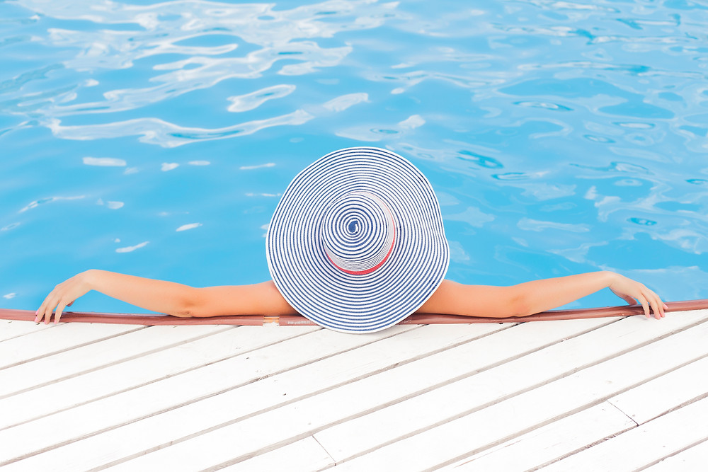Woman in the pool on vacation