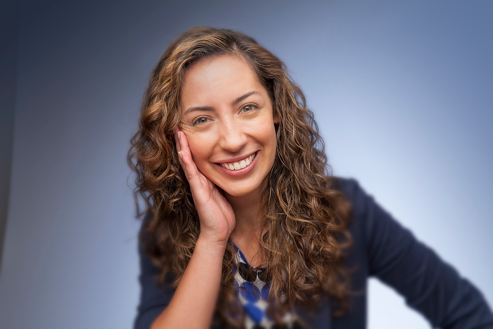 Woman smiling with blue background