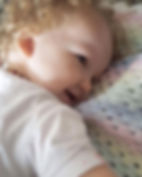 Bonnie with her beautiful rainbow blanke