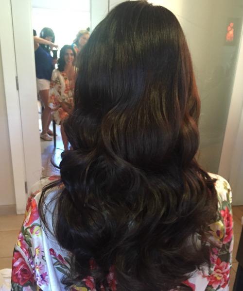 woman's hair long dark brown curls weddi