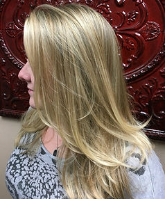 woman's hair blonde highlights shoulder