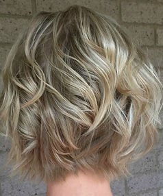woman's hair short blonde wavy bob.jpg