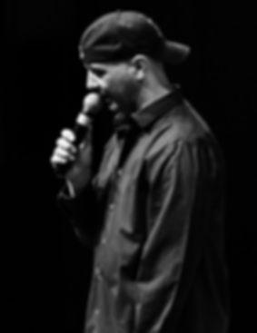 Steve Burr onstage at Comics Against Cancer 3