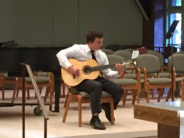 Colby Masse, a senior at Mt Greylock Regional Hig School performs for the audience and Bennincgont County Choral Society judges at on May 13, 2015. The self-taught classical guitarist's program included his own re-imagining of the opening movement of Beethoven's 'Moonlight' Sonata.
