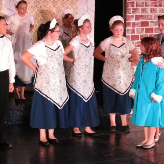 Annie meets the staff at Oliver Warbucks