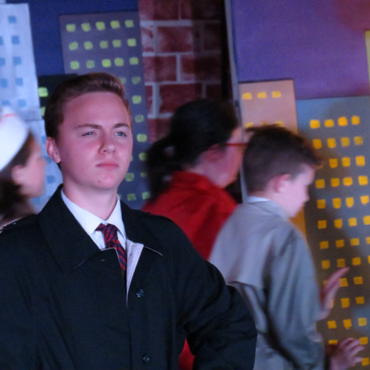 Warbucks contemplates what to do with Annie
