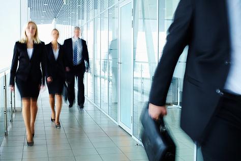 Businesspeople walking in hallway