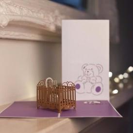 Cardology Baby in Cot greetings card