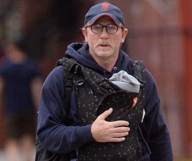 Daniel Craig carrying his new baby