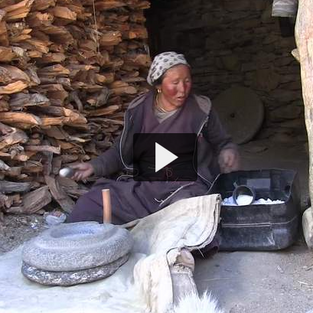 A NarPhu Woman Grinds Salt for the Yaks