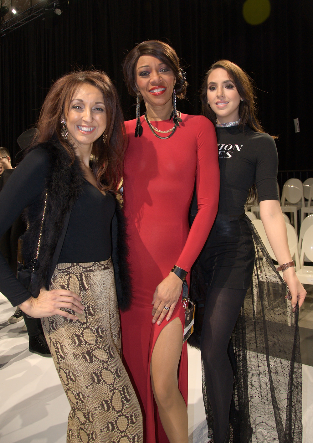 With Kara Granger (far right) and model Stephanie Riding-Cunningham (centre) wearing a Kara Louise Collection dress.