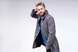 bigstock-Male-Fashion-Model-Walking-Wit-107192831