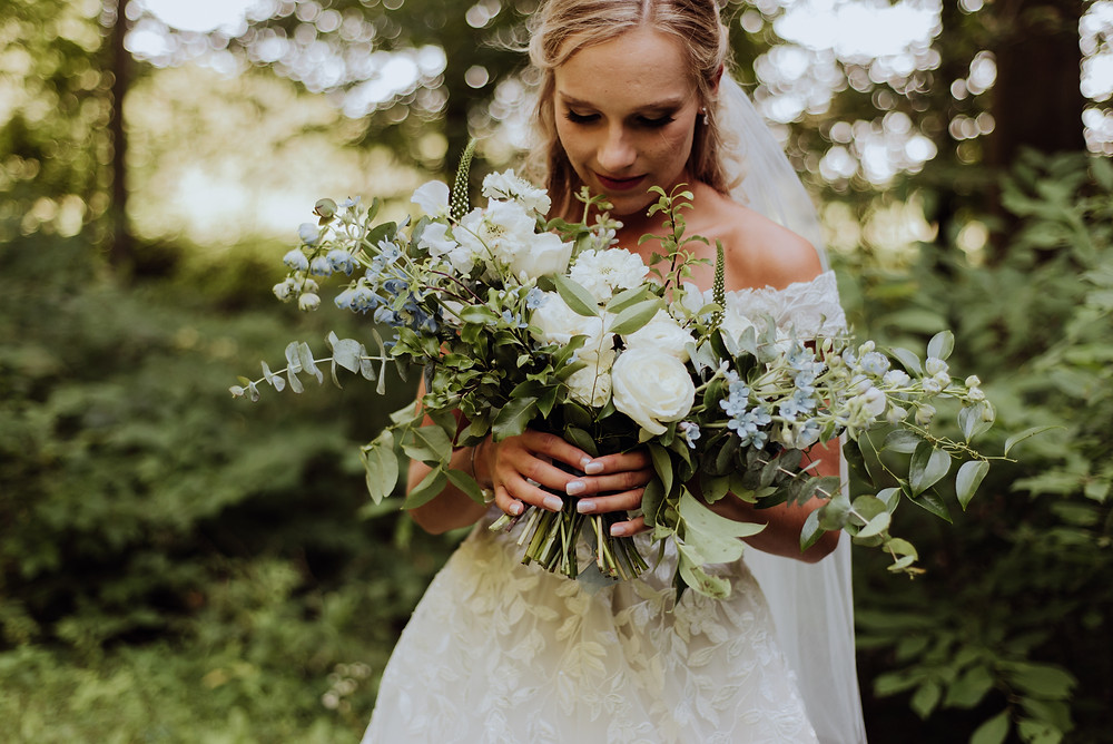 Blue and white wedding bouquet in Stratfordville, Ontario. Photo by Up and Away Photography.