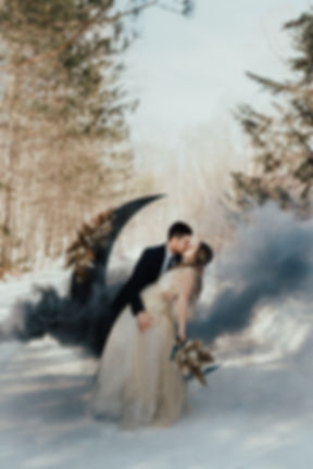 Bride and Groom outdoors in the snow in