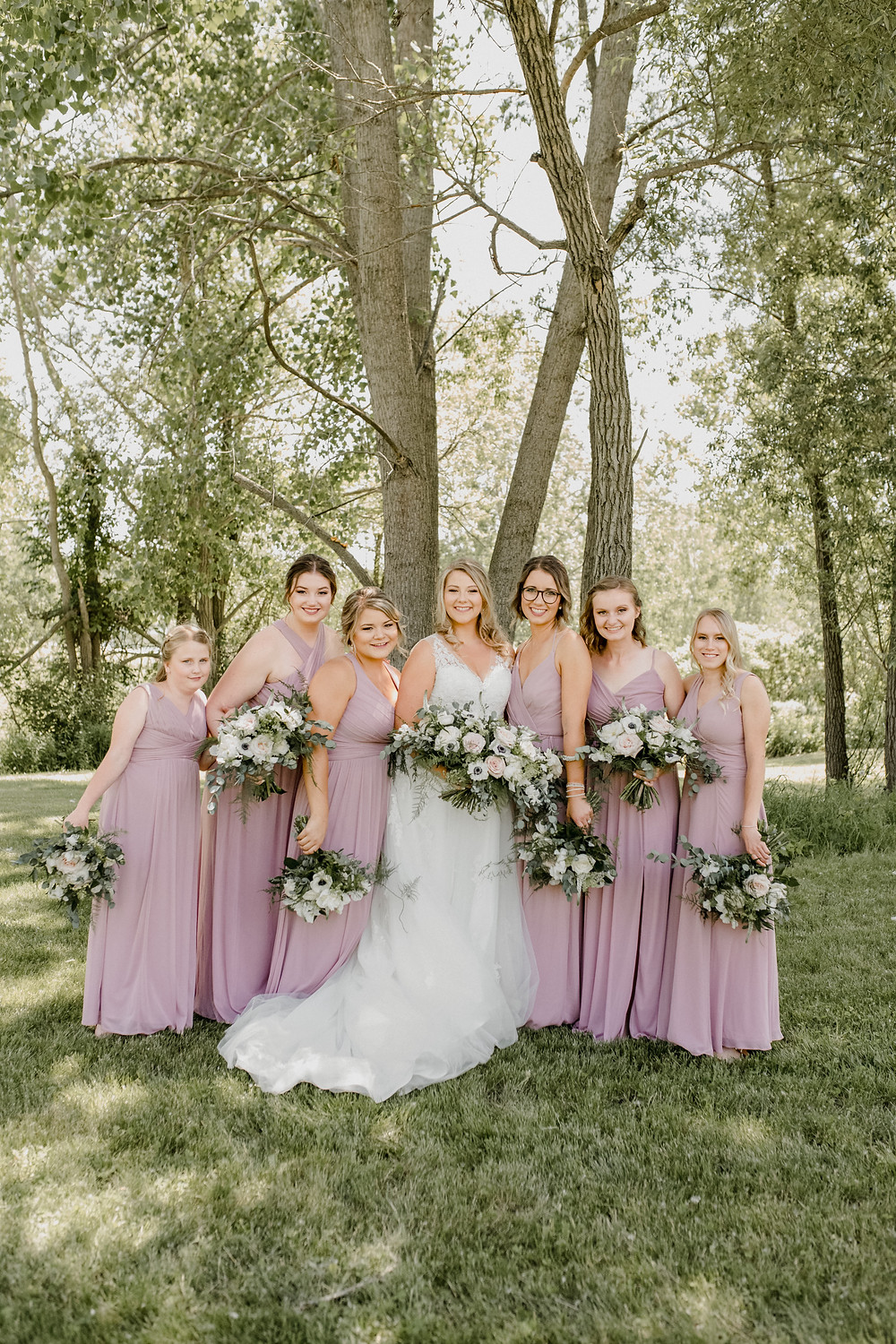 Mauve summer wedding at the Pleasant Valley Trout Farm in Sparta, Ontario. Photo by Sara Wiebe Photography.