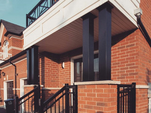 Porch railing with columns and decorative railing above