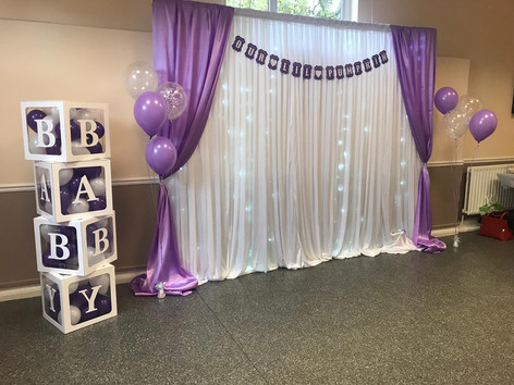 White Backdrop with Lilac Draped Sides