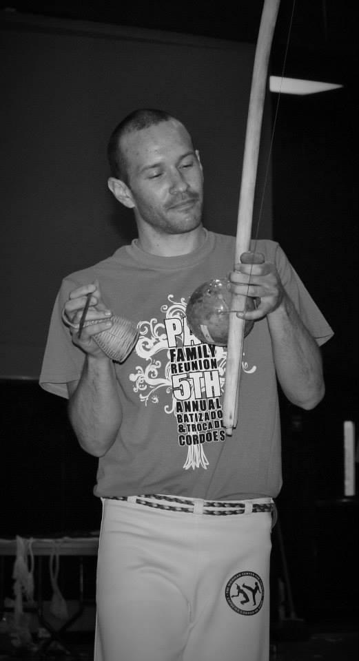 Contra-Mestre Baz playing berimbau