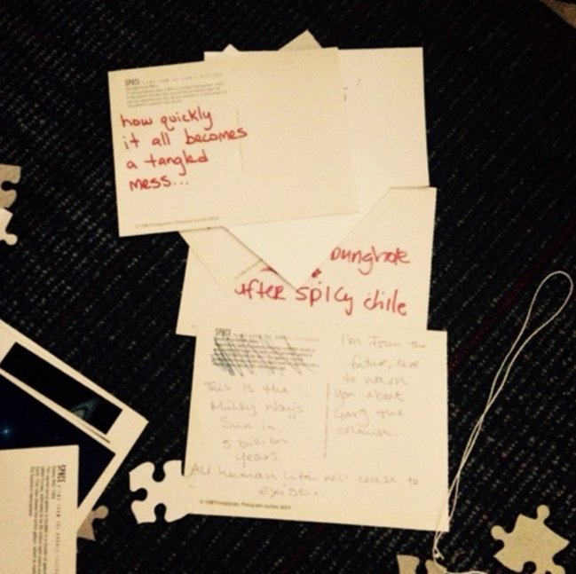 postcards with messages from visitors