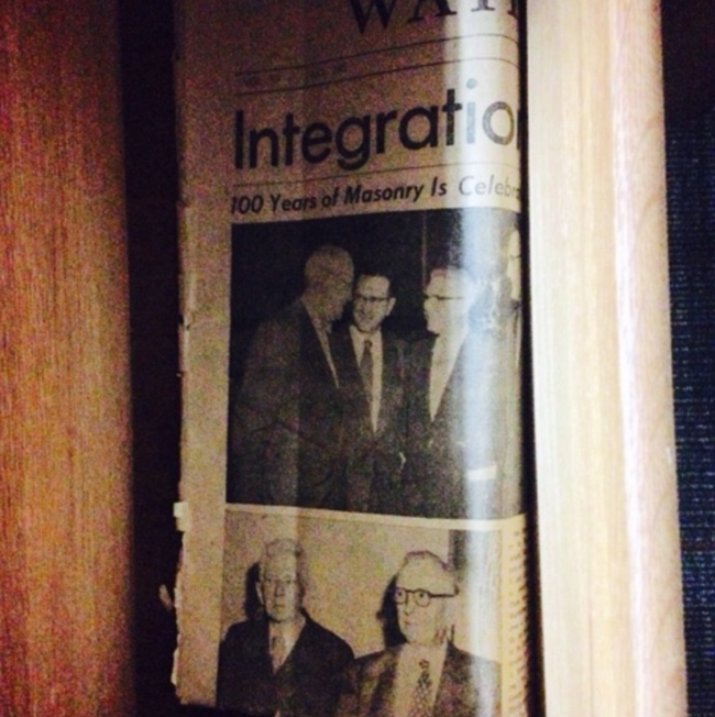 newspaper article about demonstration against integration