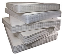pile-of-stacked-bed-mattresses.jpg