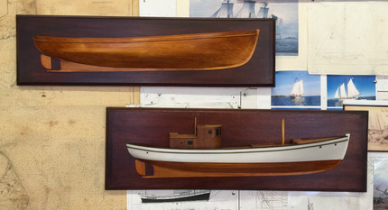 Two half models of Maine Sardine Carrier, Oquirra: one is a working half model detail and the other half is the model and cabin.